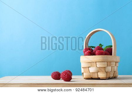 Raspberry Fruit Basket On Blue Background