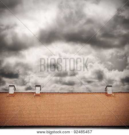 stormy sky and tiled roof top