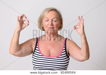 Adult Woman Doing Yoga With Okay Hand Signs