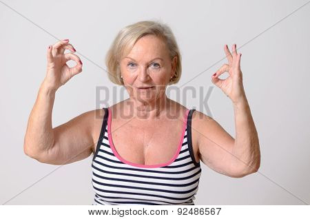 Middle Aged Woman Showing Two Okay Hand Signs