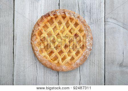 Apple pie on wood