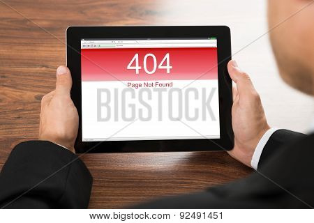 Businessman Holding Digital Tablet With Error Screen