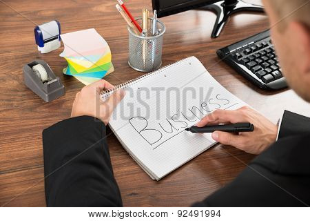 Businessman With The Text Business On Notebook