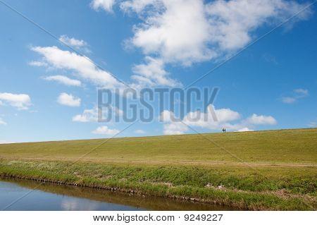 Walking At The Dike