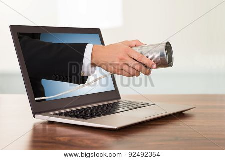 Businessperson Hand With Cans Phone From Laptop