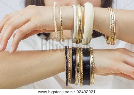 Girl's Hands With Golden Bracelets
