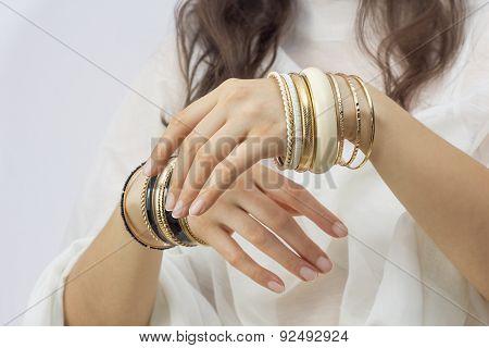 Girl's Hands With Golden Bracelets