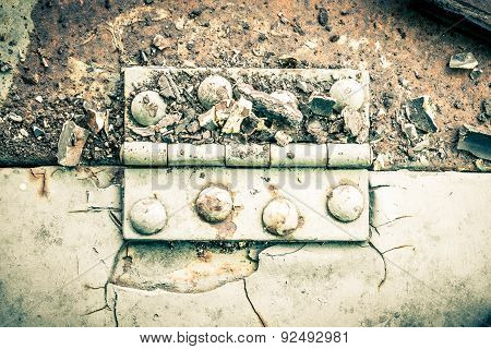 Hinge And Rust And Rivet On Metal Sheet Horizontal High Contrast Style