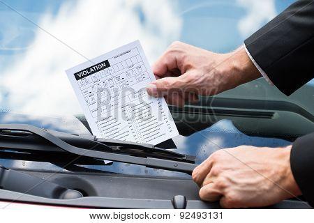 Parking Ticket On Car's Windshield
