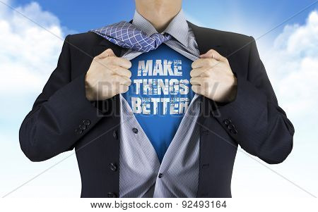 Businessman Showing Make Things Better Words Underneath His Shirt