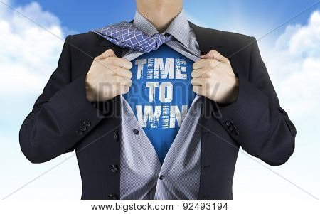 Businessman Showing Time To Win Words Underneath His Shirt