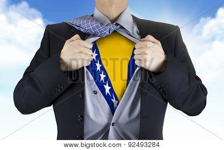 Businessman Showing Bosnia And Herzegovina Flag Underneath His Shirt
