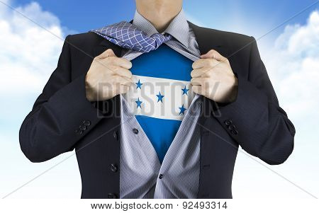 Businessman Showing Honduras Flag Underneath His Shirt