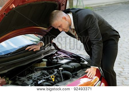 Man Watching The Engine Of A Car
