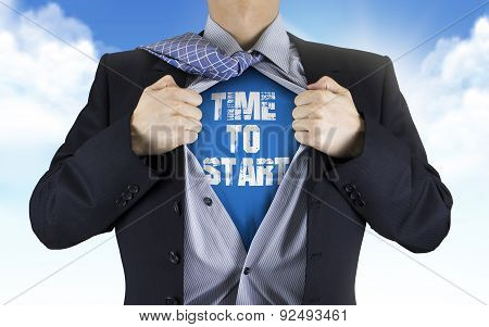 Businessman Showing Time To Start Words Underneath His Shirt