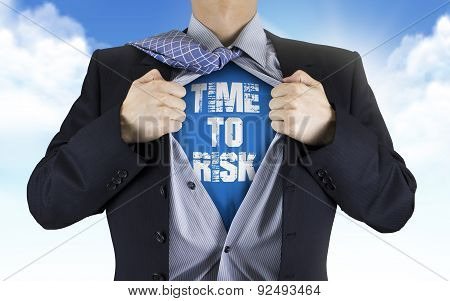 Businessman Showing Time To Risk Words Underneath His Shirt