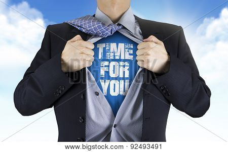 Businessman Showing Time For You Words Underneath His Shirt