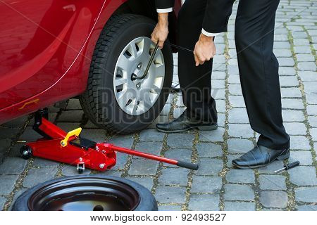 Man Changing Wheel Of A Car