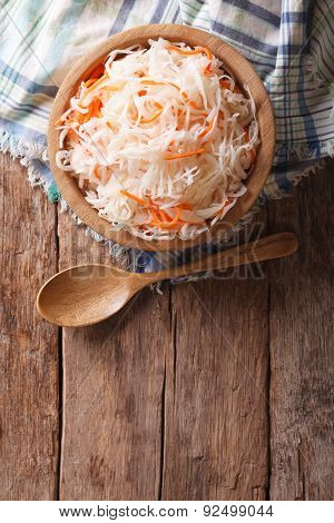 Sauerkraut And Carrots In A Wooden Plate. Vertical Top View