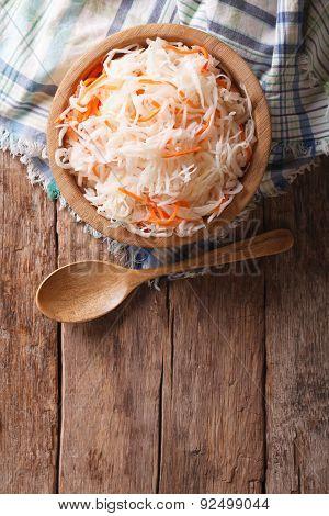 Sauerkraut And Carrots In A Wooden Plate. Vertical Top View