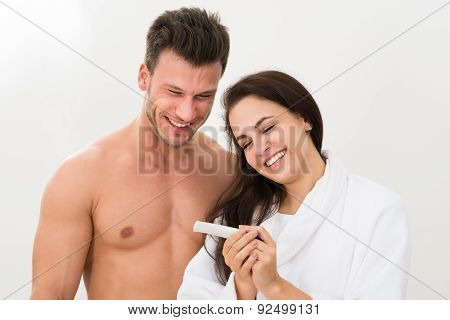 Couple Finding Out Results Of A Pregnancy Test