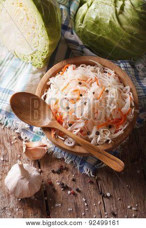 Sauerkraut And Carrots In A Wooden Plate Vertical Top View
