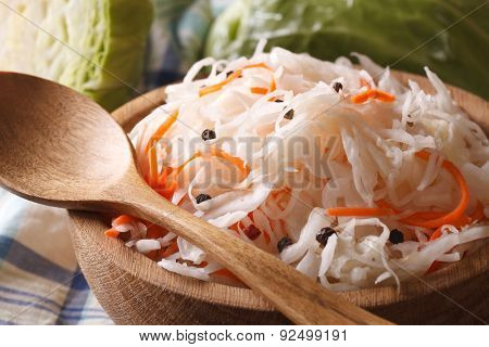 Sauerkraut And Carrots In A Wooden Plate Macro Horizontal