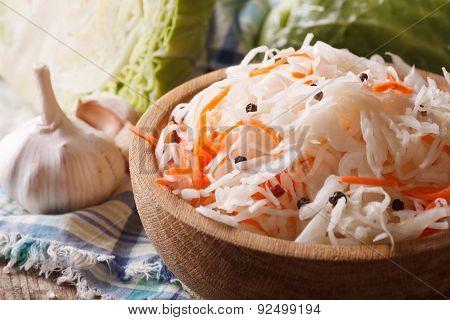 Homemade Sauerkraut With Carrot In A Wooden Plate