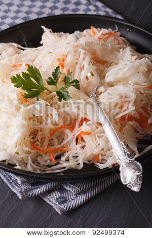 Fresh Sauerkraut In A Plate Close-up Vertical