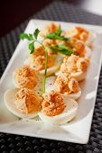 image of yolk  - Stuffed eggs with mustard and yolk in a plate one portion