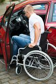 pic of handicapped  - Handicapped Man Sitting On Wheelchair Boarding In His Car - JPG