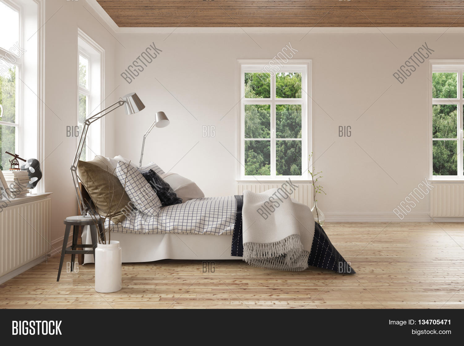 modern light airy bedroom interior with windows on all sides and a