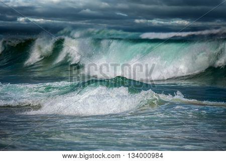 Dangerous stormy weather - dramatic seascape - dark clouds and big ocean waves