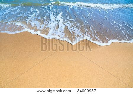 Sea or Ocean Beach with gentle blue surf of wave and  clean yellow sand - Summer concept background