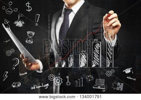 Financial growth concept with businessman holding document and drawing abstract business chart on dark background