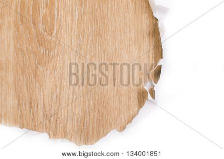 Ripped paper revealing wooden surface. Mock up
