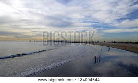 Beach landscape with clouds reflected in the water.  Shot in Seal Beach, CA.