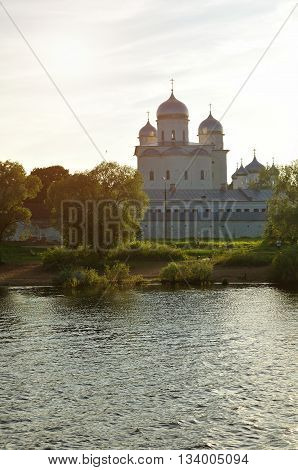 Architecture summer landscape - St George cathedral of Yuriev monastery on the bank of the Volkhov river in Veliky Novgorod Russia. Sunset summer architecture view in backlight