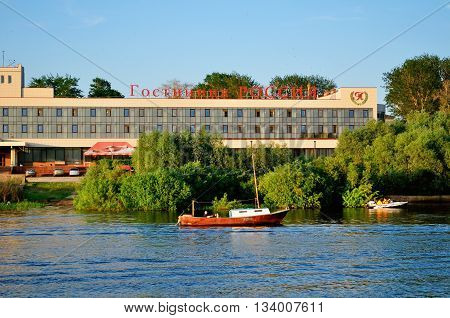 VELIKY NOVGOROD RUSSIA - MAY 29 2016. Facade of two-star Rossiya hotel at the bank of Volkhov river at summer evening architectural summer view