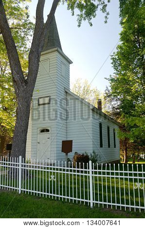 historic landmark church building behind white fence in inver grove heights minnesota