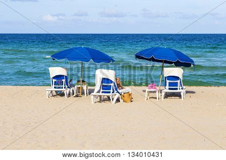 Beautiful South Beach With Chairs And Parasol In Miami