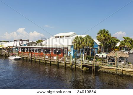 NAPLES, USA - AUG 4, 2013: old city dock in tropical Naples Florida
