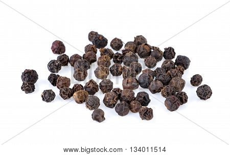 dry peppercorns isolated on a white background