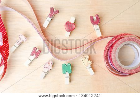 Thank You Word Of Clothesline With Cute Ribbons On Wooden Background