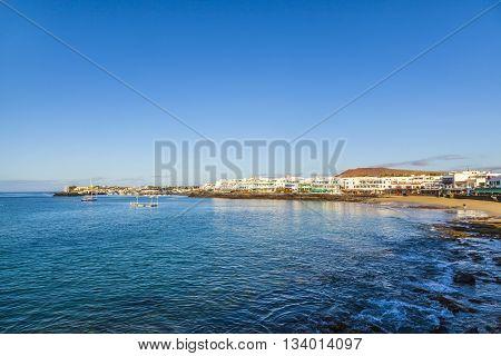 Promenade Of Scenic Playa Blanca With Seaside In The Morning