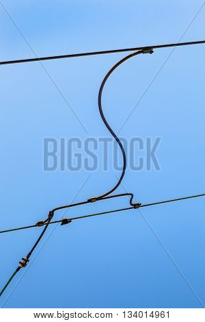 Railroad Overhead Lines Against Clear Blue Sky