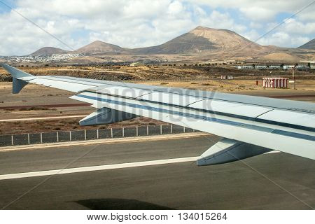 Takeoff At Airport Of Lanzarote With Volcanoes At The Horizon