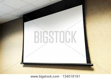 projector white screen hanging on the wall