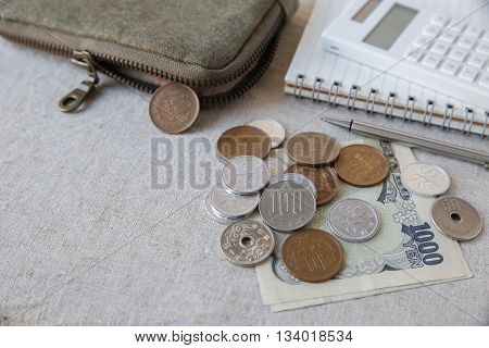 Japanese money Yens wtih calculator notebook and small money pouch