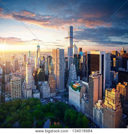 New York City Central Park at sunrise. New York background. New York City sunrise. New York Manhattan. New York colorful view. City of New York at cloudy sunrise.
